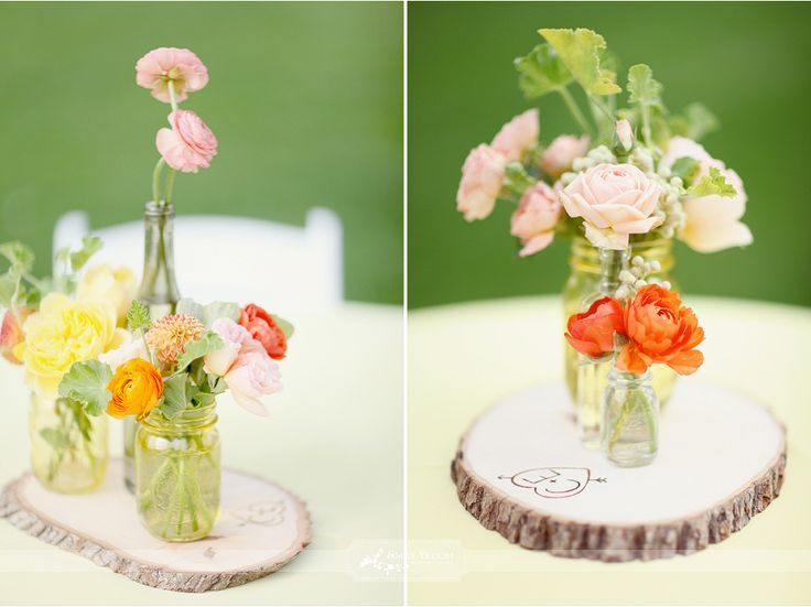 A simple and pretty wedding centerpiece for a garden wedding. Notice the initials engraved on the wood.