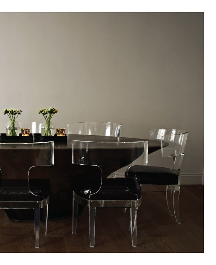 Clear andrew martin perspex klismos chairs upholstered in a crackle