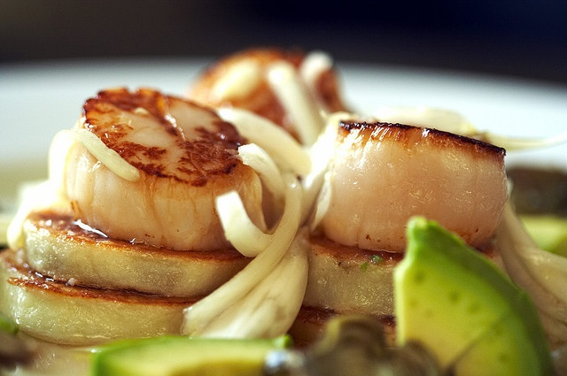 seared scallops over pan roasted potatoes in Italian butter. Citrus ...