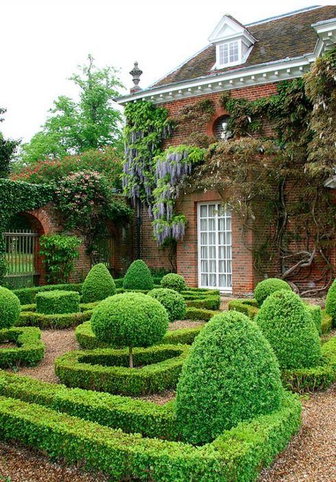 Boxwood garden, gravel, wisteria, dentil architectural details, dormers