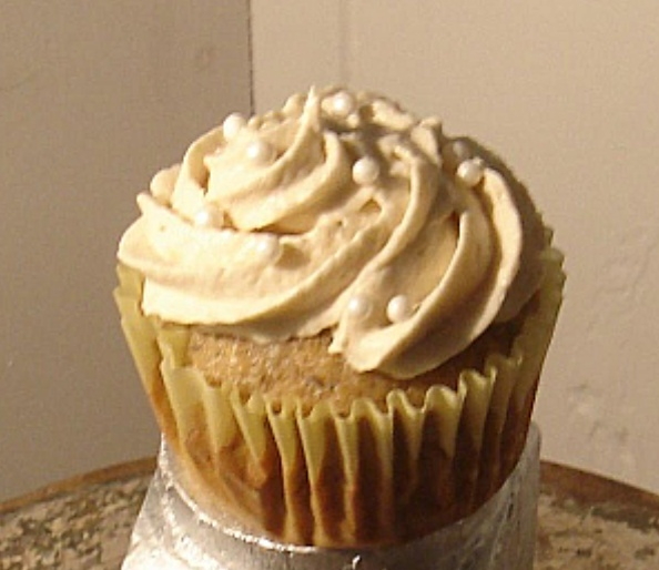 : Banana cupcake with rum and pecans topped with vanilla rum cream ...