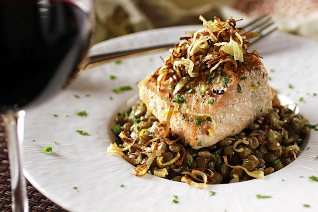 Olive oil poached salmon with lentils, bacon, and crispy fried leeks