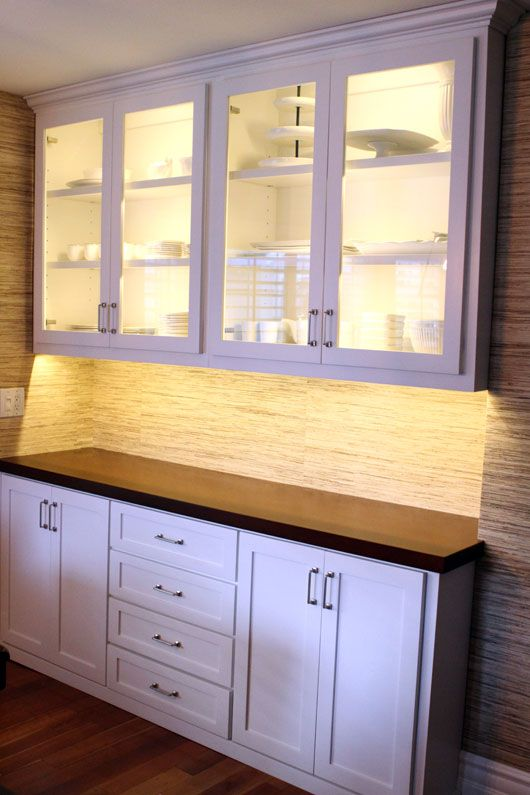 white built in cabinets dining room used for craft supply storage