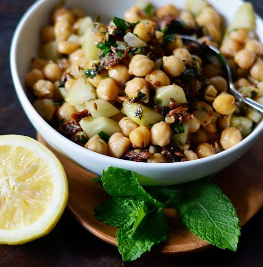 Warm chickpea salad - more chickpea deliciousness! This has cucumber and sun dried tomatoes, plus cumin and garlic.
