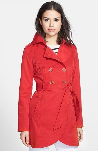 Free shipping and returns on GUESS Cutaway Front Trench Coat at Nordstrom.com. A graceful cutaway hem updates a lightweight trench with double-breasted styling marked with metallic-rimmed buttons.