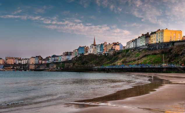 The pastel Georgian buildings of Tenby, Wales, seem to spill right out onto the sand.   (Geoffrey Kuchera / Dreamstime.com)