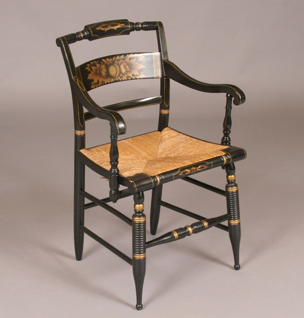 This is a hitchcock chair which was designed by lambert hitchcock and