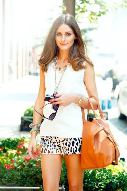 Olivia Palermo in leopard shorts and a leather bag.
