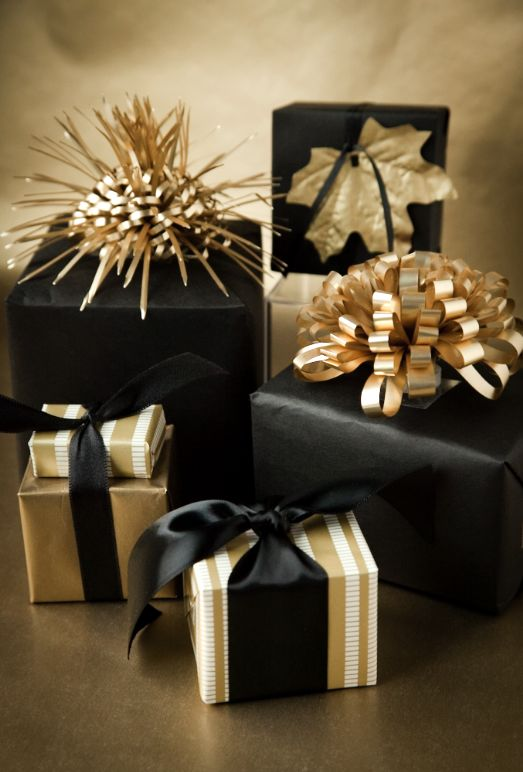 Glamorous gold and black gift wrap #packaging!!! Bebe'!!! Love this festive and dramatic gift wraps!!! Bebe'!!! Love these elegantly wrapped gifts!!!!