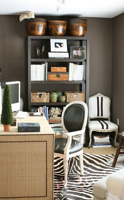 Amazing upholstered desk and that black and white striped chair