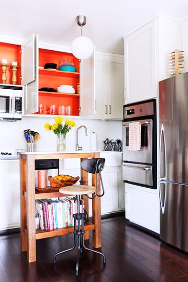 Home Tour: An Interior Designer's Smart and Stylish Small Space // Orange cabinets and kitchen island