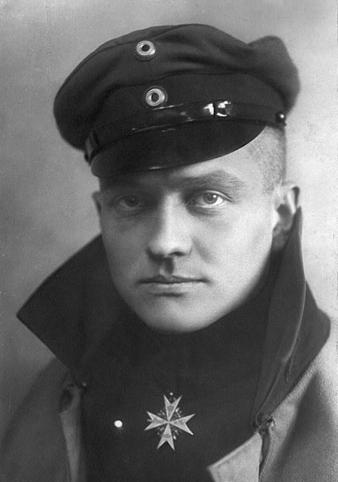 "Manfred von Richthofen - the ""Red Baron"". Despite crashing on his first solo flight, Richthofen would soon become infamous among Allied soldiers and a national hero within Germany.  Between 1916-1918 he would attain 80 confirmed combat victories. This picture was taken in 1917; in April of 1918 he was shot down and killed at the age of 25."