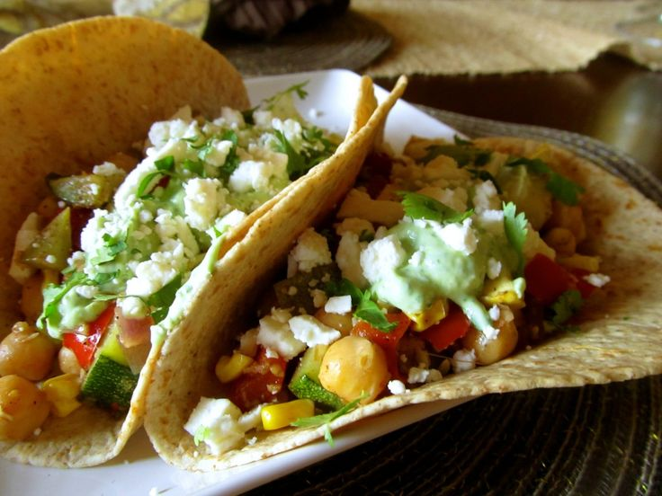 Roasted veggie tacos with avocado and yogurt cream