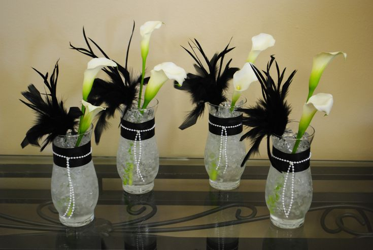 These custom centerpieces are adorned with pearls for 1920 party decoration ideas