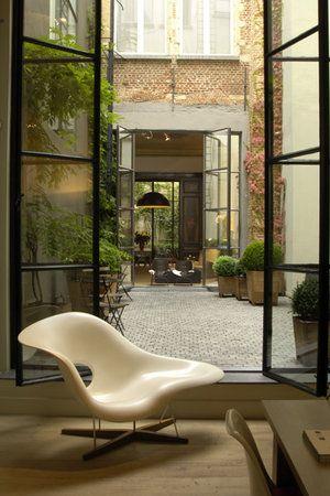 breezeway with iron doors/windows