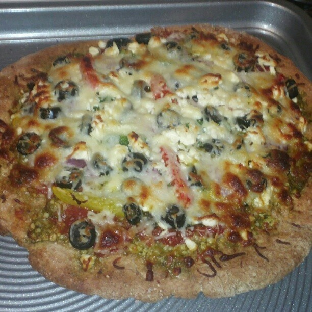 wheat crust pizza loaded with garlic, pesto, tomatoes, fresh basil ...