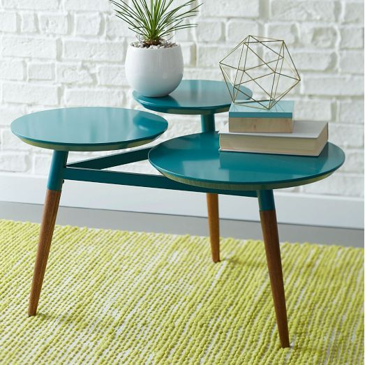 With its turned pecan wood legs, varied surface heights and colorful coatings, our Clover Coffee Table is a youthful take on mid-century modern.