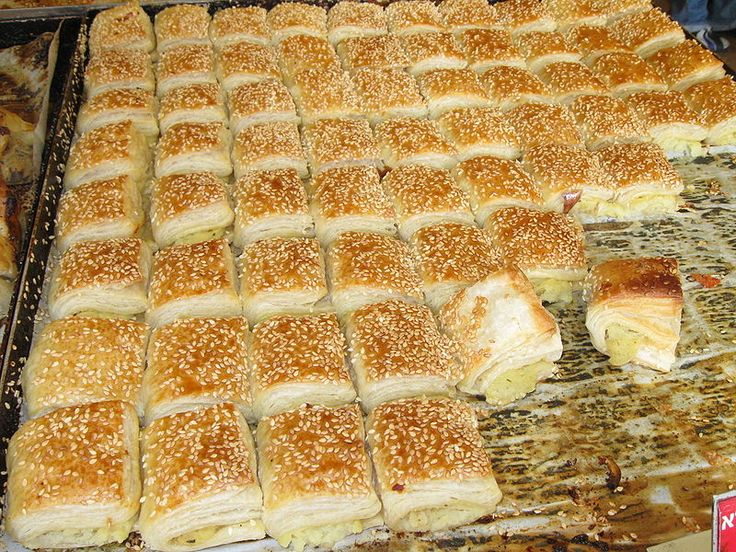 Freshly-made potato bourekas on sale at a stall in Mahane Yehuda ...