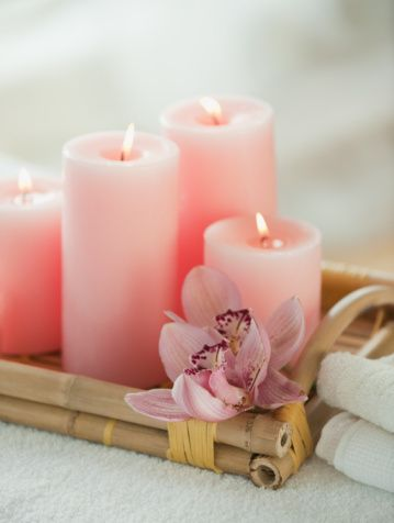 Pink candles on a bamboo tray