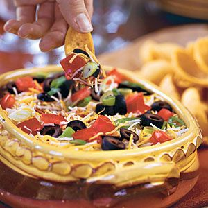 16 Easy Outdoor Appetizers | Layered Spicy Black Bean Dip | SouthernLiving.com