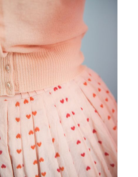 Adorable heart skirt in red with pink sweater. Great Valentine's Day fashion.