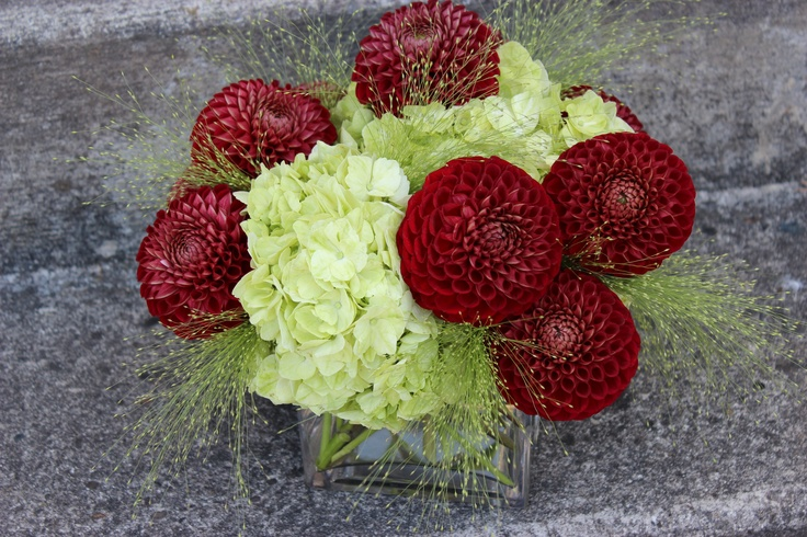 Red and green centerpiece with dahlia hydrangea http