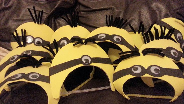 Despicable Me Minion party hats! Glue big googly eyes on strips of black craft-foam with cut with goggle outlines. Glue onto yellow craft-foam visors, then poke black pipe-cleaners through the edge for hair. Wear upside-down, like a headband.