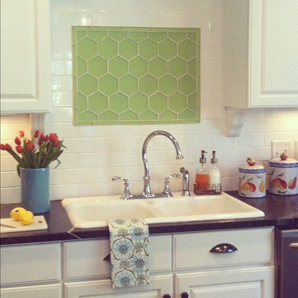 color tile inlaid to the backsplash above the sink love the honeycomb