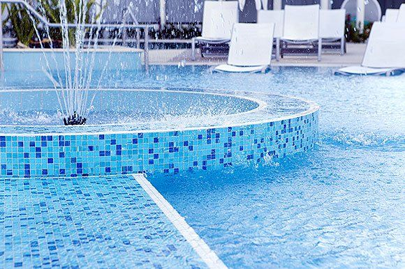 Pool tile designs swimming pools pool tile ideas for Pool design nz