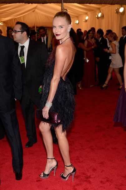 Kate Bosworth wearing a dress, shoes, and clutch by Prada.