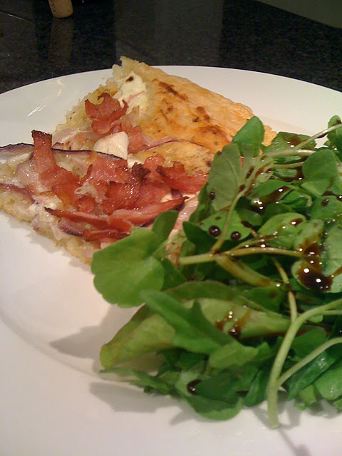 ... pizza, topped with red onions, bacon, cream cheese and spring onions
