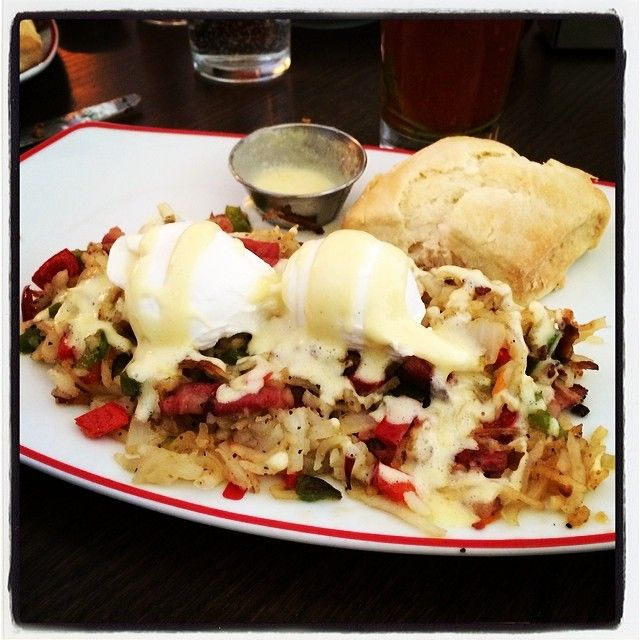 Perfectly poached eggs over pastrami hash. Drizzled with hollandaise ...