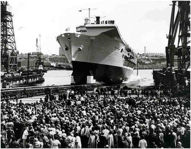 HMS Ark Royal - Launch - 20 JUNE 1981  HMS Ark Royal was the former flagship of the Royal Navy. One of three Invincible class aircraft carriers she was affectionately known as The Mighty Ark. Her keel was laid by Swan Hunter at Wallsend on 7 December 1978 and she was launched on 20 June 1981 and completed in 1985.     Most photographs and images in this set are taken from the Swan Hunter Collection held by Tyne and Wear Archives Service.    Ref: TWAS:ds-swh-4-ph-5-109-31