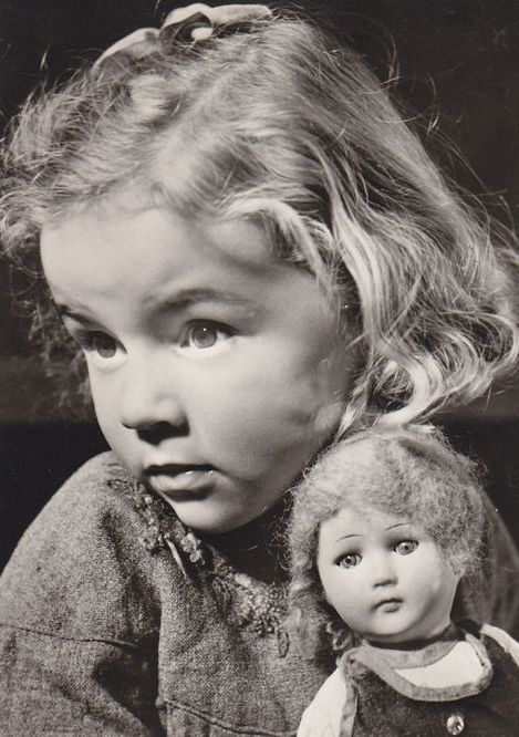 .Wistful girl and doll