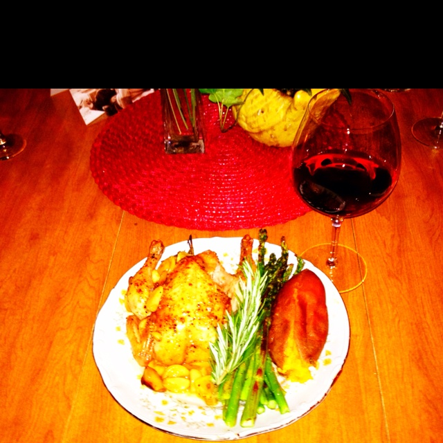 Cornish game hen seasoned with rosemary and lemon served with ...