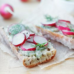 baguette slices with anchovies, radishes and butter