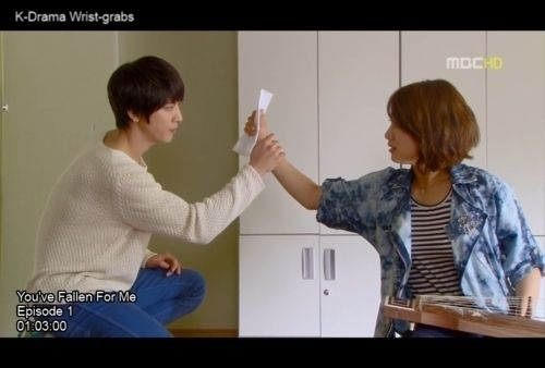 Hand holding 21 reasons korean dramas are ridiculously frustrating