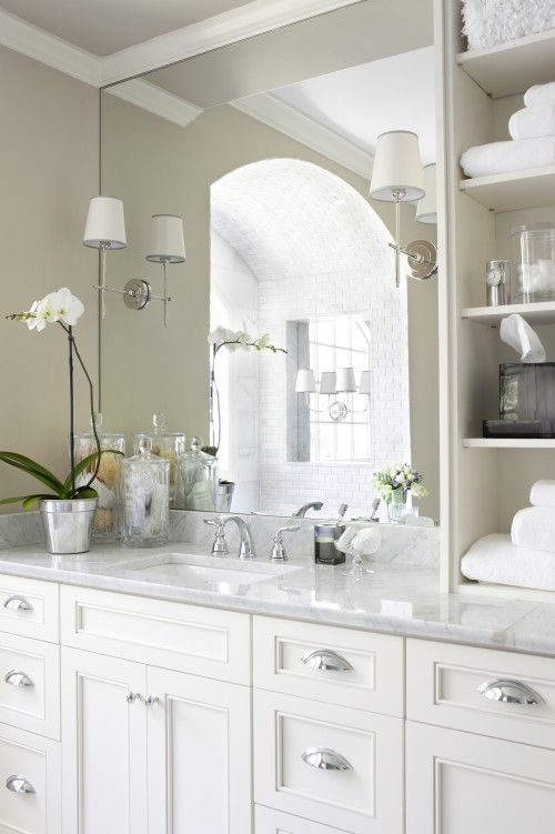 lights on mirror, white cabinets, shelves