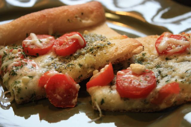 Tomato Pesto Pizza - pizza crust, pesto (LOTS), cherry tomatoes ...