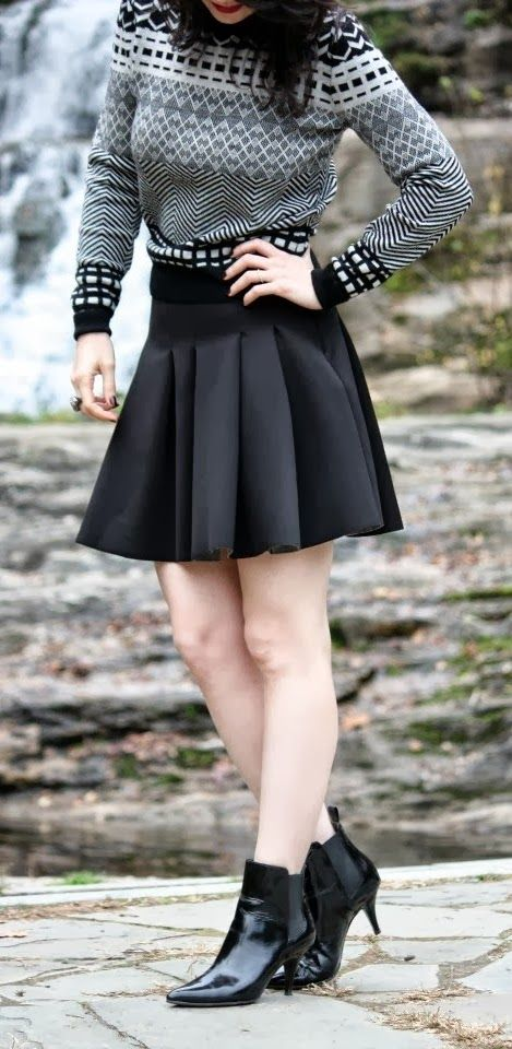 colourful sweater with black skirt