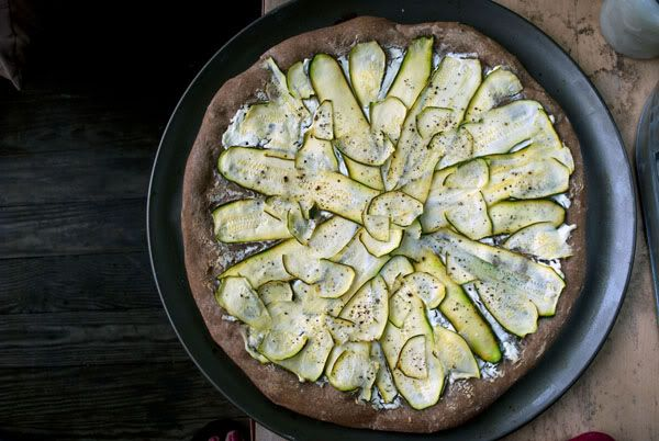 Whole wheat pizza crust with goat cheese, zucchini, lemon juice, and ...