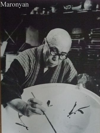 National Living Treasure of Japan, Shoji HAMADA (1894~1978), pottery artist, at work.