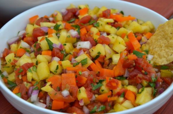 Flavorful salsa with pineapple, tomatoes, peppers, cilantro, lime and ...