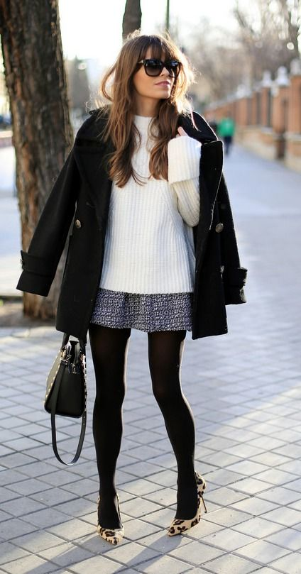 Long light sweater + short full skirt + black tights + light/printed footwear.