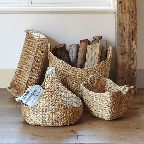 Water hyacinth storage - basket handle for throw blankets in guest room; shallow one for pillow storage in guest room