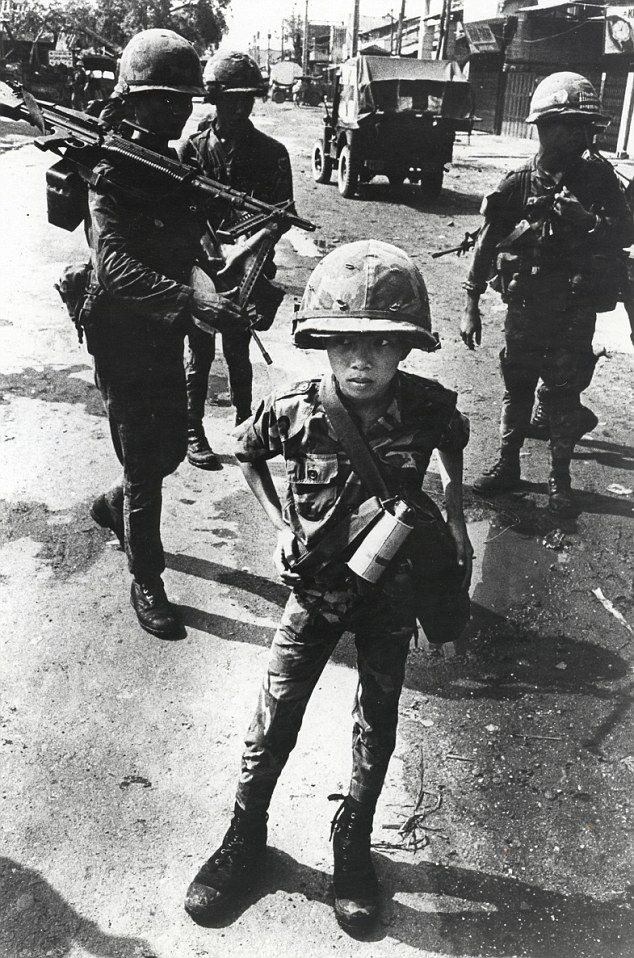 """This Vietnamese child was nicknamed 'Little Tiger' for allegedly killing two 'Viet Cong women cadre' - his mother and teacher."""