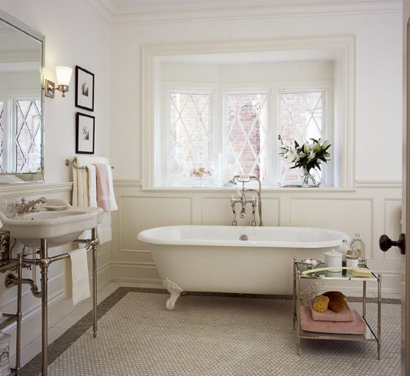 bathrooms - claw foot tub beveled mirror porcelain sink chrome base white carrara marble hexagon tiles floors polished chrome faucet sconces wainscoting mirrored table bathroom