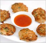 ... spiced fish cakes are served with sweet chili sauce for dipping
