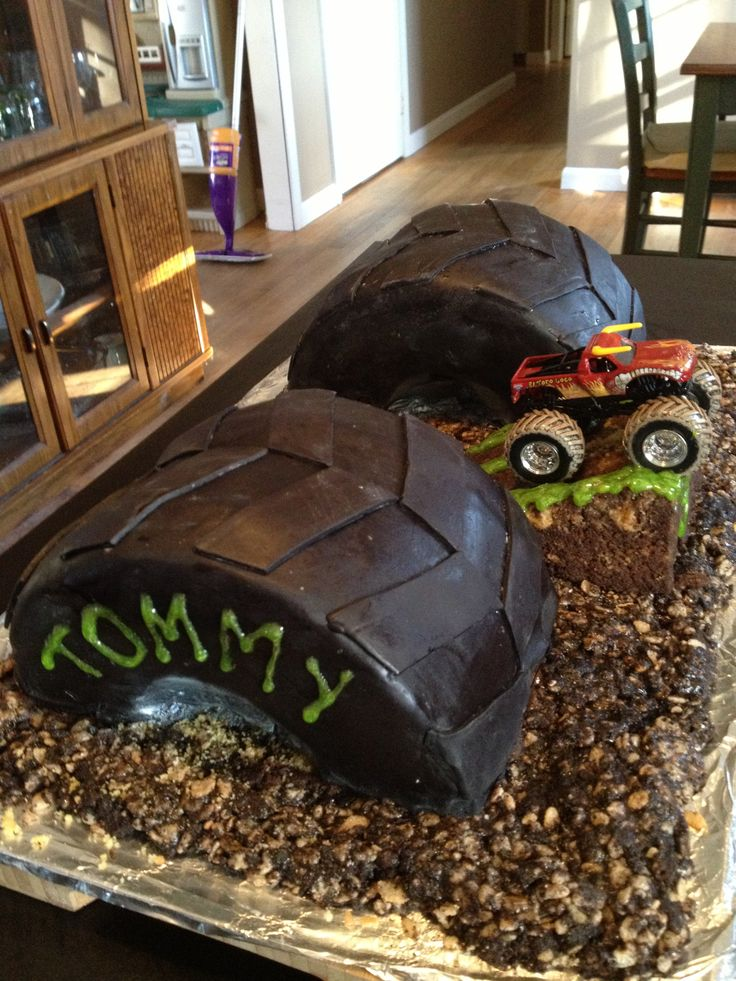"Monster truck birthday cake - 2 8"" round cake layers per tire, halved ..."
