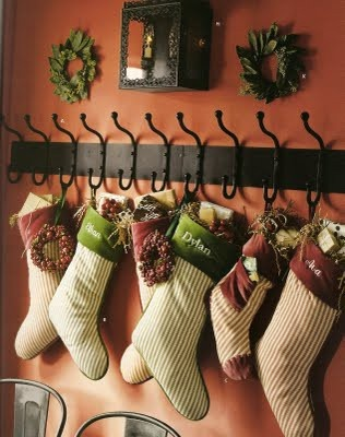 idea for the home without a fireplace - hang those stockings on a coat rack.